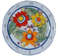 Orologio con fiori grandi Nino Parrucca su Piatto