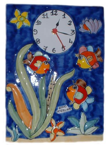 Orologio con pesci Nino Parrucca a rilievo
