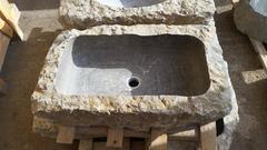 Lavabo in pietra naturale grigia