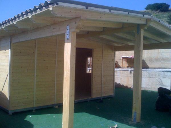 Casetta in legno con veranda corso legnami srl confort for Casetta in legno con portico