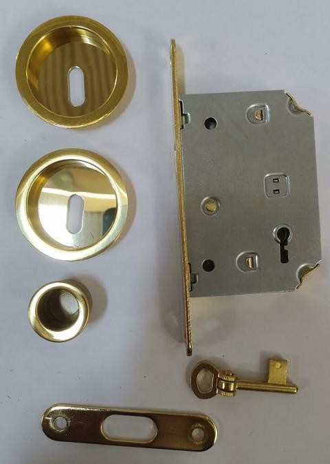 Serratura per porta scorrevole kit tondo con chiave a snodo Ottone lucido Forme Kit chiave a snodo Ottone lucido