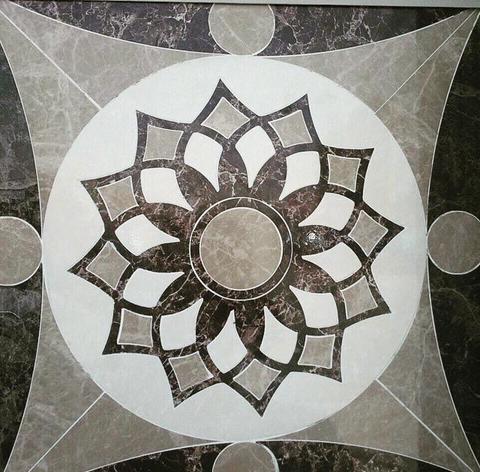 Pavimenti waterjet con intagli su marmo e graniti.