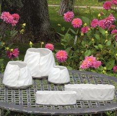 Vasi e vaschette frastagliate