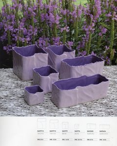 Cubi frastagliati  e vaschette in ceramica