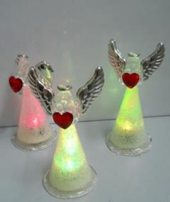 Angeli in vetro e argento con luce