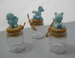 Barattolo in vetro H 10 con soggetto in resina celeste  in 3 modelli