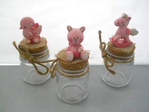 Barattolo vetro H 10  con soggetto in resina rosa in 3 modelli