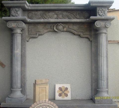 Camino  Barocco in marmo grigio